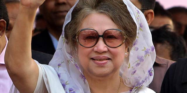 FILE - In this Jan. 20, 2014 file photo, Bangladesh's former Prime Minister and opposition Bangladesh Nationalist Party (BNP) leader Khaleda Zia, waves as she arrives for a public meeting in Dhaka, Bangladesh. A Bangladesh court issued an arrest warrant Wednesday for the ex-Prime Minister in two graft cases after she failed to appear in court for the fourth time. (AP Photo/A.M. Ahad, File)