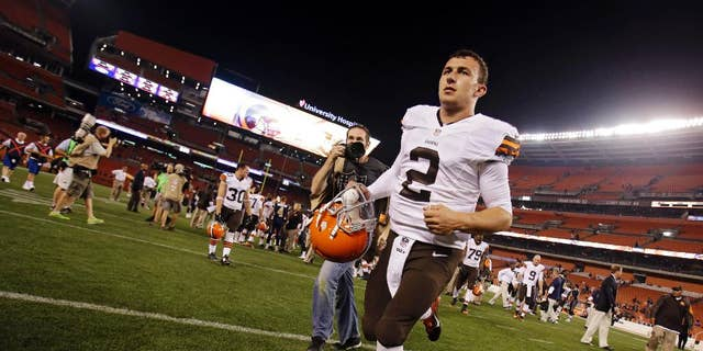 Cleveland Browns quarterback Johnny Manziel (2) runs off the field after a 33-14 loss to the St. Louis Rams in a preseason NFL football game Saturday, Aug. 23, 2014, in Cleveland. (AP Photo/Tony Dejak)