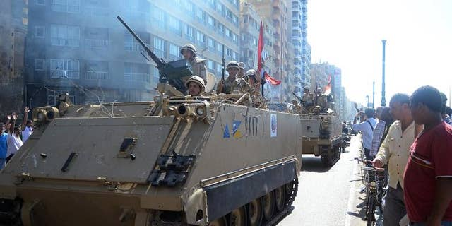 Egyptian security forces patrol the seafront in Alexandria during a demonstration in support of ousted Islamist president Mohamed Morsi, September 20, 2013