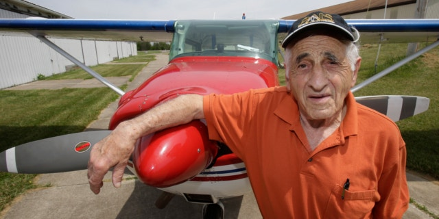 May 30, 2013: John Lawton poses by his Cessna 172 airplane in Wadsworth, Ohio. Lawton will attempt to make 90 flying passages across the U.S.-Canadian border.