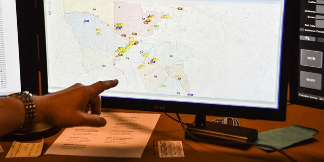 In this photo taken March 15, 2018, a supervisor shows one of the maps used by dispatchers at a 911 call center in Roswell, Ga. The Roswell call center is one of the few in the United States that accepts text messages. This year is the 50th anniversary of the first 911 call placed in the United States and authorities say it is in desperate need to have its technology modernized. (AP Photo/Lisa Marie Pane)