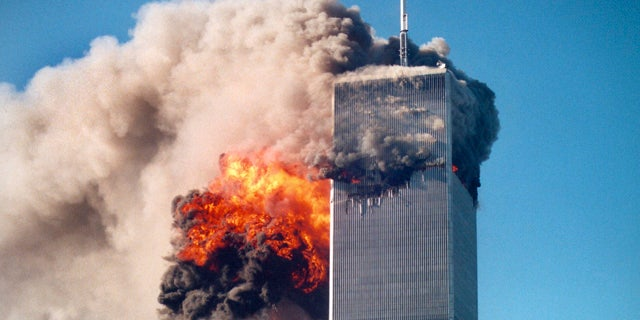 """This photo by Roberto Robanne, provided in New York by the National September 11 Memorial & Museum, included in their """"September 11 Attacks Timeline,"""" shows the impact of one of the airplanes during the World Trade Center attacks in New York, Sept. 11, 2001. (AP/National September 11 Memorial & Museum)"""
