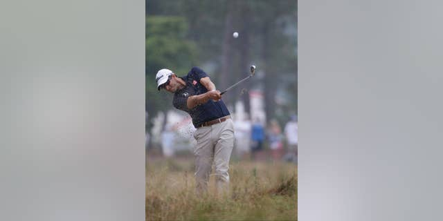 Adam Scott, of Australia, hits from the natural area on the 12th hole during the second round of the U.S. Open golf tournament in Pinehurst, N.C., Friday, June 13, 2014. (AP Photo/David Goldman)