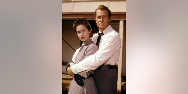 """** FILE** Darren McGavin, right, and Elizabeth Montgomery are seen in a scene from the television series """"Riverboat"""" in this Aug. 18, 1959 file photo. McGavin, the husky, tough-talking actor who starred in the TV series """"Mike Hammer,"""" played a grouchy dad in the holiday classic """"A Christmas Story"""" and had other strong roles in such films as """"The Man with the Golden Arm"""" and """"The Natural,"""" died Saturday, Feb. 25, 2006. He was 83. (AP Photo)"""
