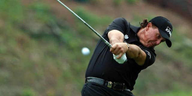 Phil Mickelson hits his tee shot on the 15th hole during the second round of the PGA Championship golf tournament at Valhalla Golf Club on Friday, Aug. 8, 2014, in Louisville, Ky. (AP Photo/Mike Groll)