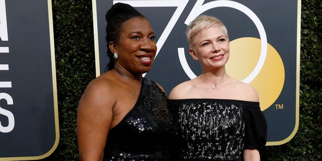 Tarana Burke (L) and Michelle Williams arrive at the 75th Golden Globe Awards in Beverly Hills, Calif., Jan. 7, 2018.
