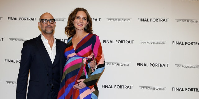 """Stanley Tucci arrives with his wife Felicity Blunt for a special screening of """"Final Portrait"""" in New York."""