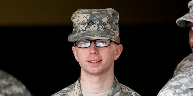 Dec. 22, 2011: Army Pfc. Bradley Manning is escorted from a courthouse in Fort Meade, Md.
