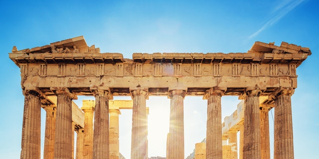 The Parthenon on the Athenian Acropolis in Sunlight. The Temple is dedicated to the Greek Goddess Athena. Athens, Greece.