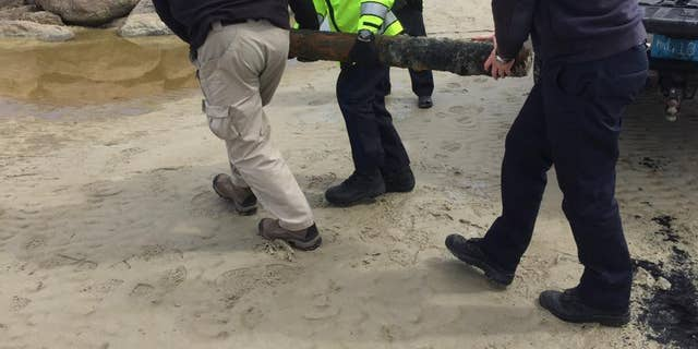 The Massachusetts State Police Bomb Squad and the Navy Explosive Ordnance Disposal were called to handle the shell.