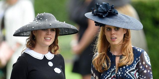 Britain's Princess Eugenie (L) and Princess Beatrice at Ascot