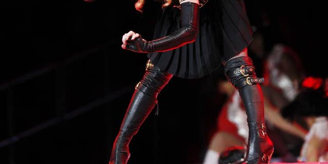 Madonna is shown sporting her thigh-high stiletto boots at the Super Bowl. Recently, the singer wore a filter-free look in NYC (Reuters)