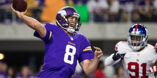 Oct 3, 2016; Minneapolis, MN, USA; Minnesota Vikings quarterback Sam Bradford (8) throws during the first quarter against the New York Giants at U.S. Bank Stadium. Mandatory Credit: Brace Hemmelgarn-USA TODAY Sports