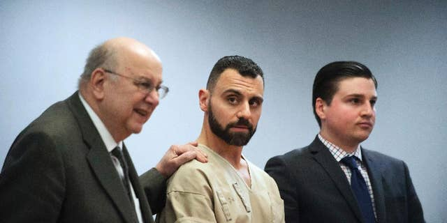 FILE - In this Monday, April 17, 2017, file photo, Richard Dabate, center, appears with attorneys Hubie Santos, left, and Trent LaLima, right, while being arraigned, in Rockville Superior Court in Vernon, Conn. Authorities said Dabate told them a masked man had entered their home Dec. 23, 2015, shot his wife and tied him up before he burned the intruder with a torch. But the New York Daily News reported the Connecticut State Police wrote in an arrest warrant that his wife's Fitbit was logging steps after the time Dabate told them she was killed. (Mark Mirko/Hartford Courant via AP, Pool, File)