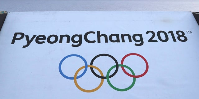 The Olympic rings with a sign of 2018 Pyeongchang Games is seen at the Imjingak Pavilion in Paju, South Korea, Friday, Jan. 19, 2018.
