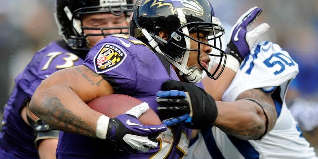 Jan. 6, 2013: Baltimore Ravens running back Ray Rice (27) is hit by Indianapolis Colts inside linebacker Jerrell Freeman (50) during the first half of an NFL wild card playoff football game in Baltimore. (AP/Nick Wass)
