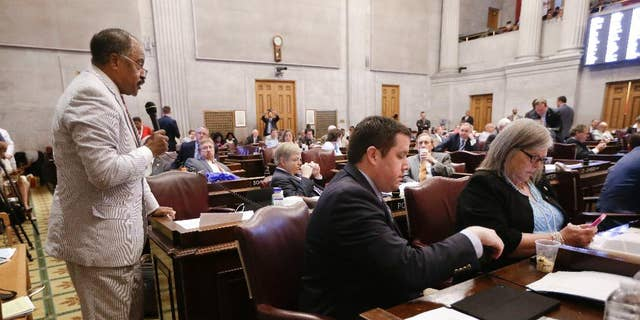 Rep. John DeBerry, D-Memphis, left, speaks during the debate to override Gov. Bill Haslam's veto of a bill seeking to make the Bible the state's official book, Wednesday, April 20, 2016, in Nashville, Tenn. The House voted not to override the veto. (AP Photo/Mark Humphrey)