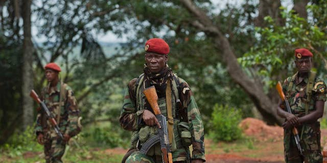 Troops from the Central African Republic stand guard in April 2012 at a building used for joint meetings between them and U.S. Army special forces, in Obo, Central African Republic, where U.S. special forces have paired up with local troops and Ugandan soldiers to seek out Joseph Kony's Lord's Resistance Army (LRA). AA rebel in charge of communications for warlord Joseph Kony has surrendered to Ugandan forces, the military said on March 30, 2017, shortly after the U.S. indicated it was pulling out of the international manhunt for one of Africa's most notorious fugitives. (AP Photo/Ben Curtis, File)