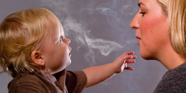 """This handout image, released on November 10, 2010 depicts a mother blowing cigarette smoke in a child's face in one of the Federal Drug Administration's proposed new """"graphic health warnings."""" Diseased lungs, dead bodies, a man on a ventilator and mothers blowing smoke in their children's faces are among the images unveiled on Wednesday that U.S. health officials are considering in their effort to revamp tobacco warning labels. REUTERS/HHS/Handout (UNITED STATES - Tags: BUSINESS POLITICS HEALTH) FOR EDITORIAL USE ONLY. NOT FOR SALE FOR MARKETING OR ADVERTISING CAMPAIGNS. THIS IMAGE HAS BEEN SUPPLIED BY A THIRD PARTY. IT IS DISTRIBUTED, EXACTLY AS RECEIVED BY REUTERS, AS A SERVICE TO CLIENTS"""