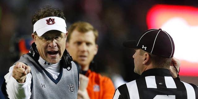 Auburn head coach Gus Malzahn speaks to official during the second half of the Iron Bowl NCAA college football game against Alabama, Saturday, Nov. 29, 2014, in Tuscaloosa, Ala. Alabama won 55-44. (AP Photo/Butch Dill)