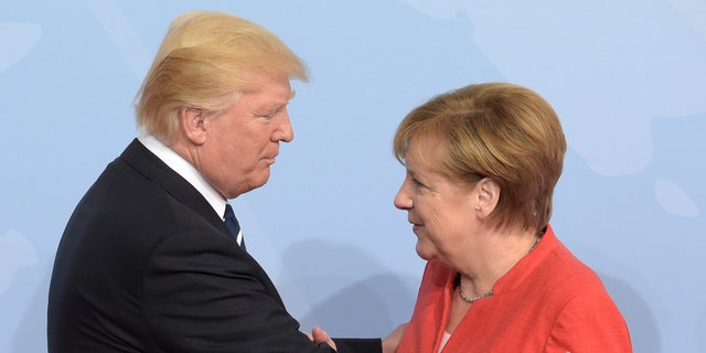 U.S. President Donald Trump, left, is welcomed by German Chancellor Angela Merkel on the first day of the G-20 summit in Hamburg, northern Germany, Friday, July 7, 2017. (Associated Press)
