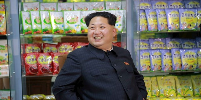 North Korean leader Kim Jong Un smiles while sitting during a visit to inspect the Pyongyang Children's Foodstuff Factory, in this undated photo released by North Korea's Korean Central News Agency (KCNA) on November 14, 2015.