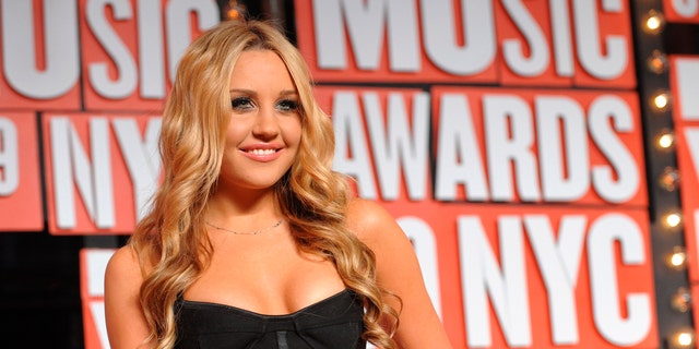 Sept. 13, 2009: Amanda Bynes arrives at the MTV Video Music Awards in New York. Los Angeles prosecutors charged Bynes on Tuesday June 5, 2012 with driving under the influence in April, when she was arrested after grazing a sheriff's car in West Hollywood.