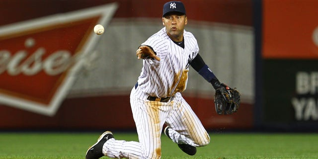 June 18, 2012: Derek Jeter of the New York Yankees flips the ball to second base to end the seventh inning from a ball hit by Michael Bourn of the Atlanta Braves during their game at Yankee Stadium in New York City.  (Al Bello/Getty Images)