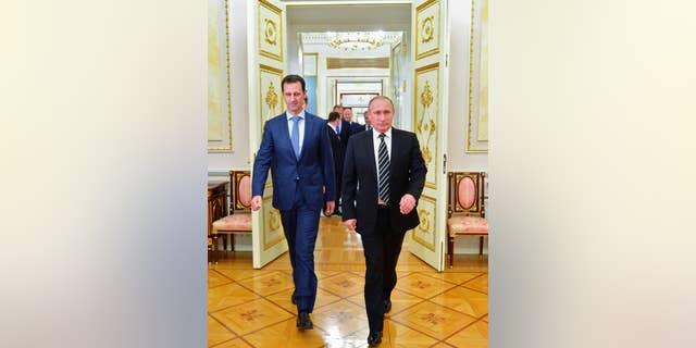 Syrian President Bashar al-Assad, left, with Russian President Vladimir Putin in the Kremlin in 2015.