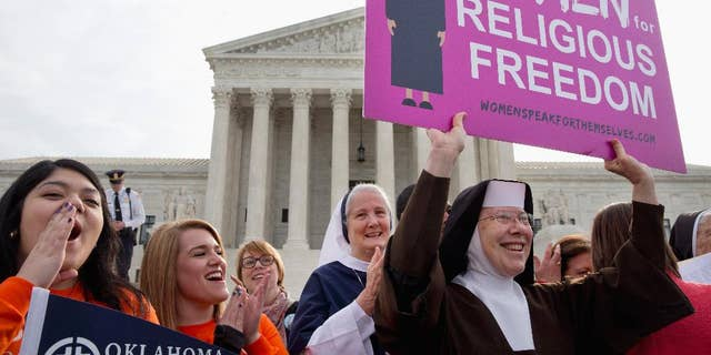 FILE - In this March 23, 2016 file photo, nuns and their supporters rally outside the Supreme Court in Washington as the court hears arguments to allow birth control in healthcare plans in the Zubik vs. Burwell case. A seemingly divided Supreme Court is exploring a possible compromise ruling in the dispute between faith-based groups and the Obama administration over birth control.  (AP Photo/Jacquelyn Martin, File)