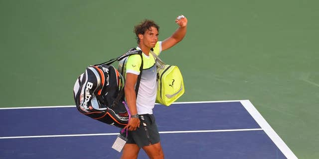 Rafael Nadal, of Spain, leaves the court after losing to Milos Raonic, of Canada, at the BNP Paribas Open tennis tournament, Friday, March 20, 2015 in Indian Wells, Calif. Raonic won, 4-6, 7-6 (10), 7-5. (AP Photo/Mark J. Terrill)