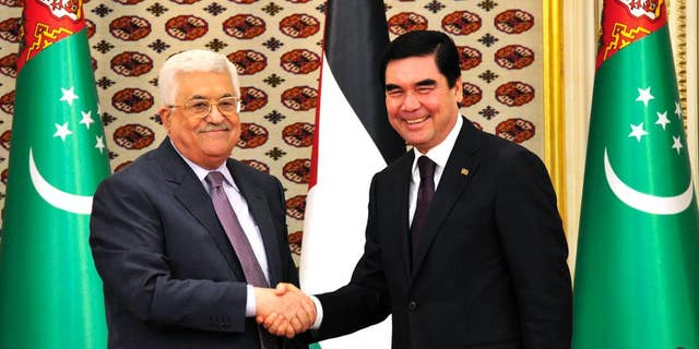 Turkmenistan's President Gurbanguli Berdymukhamedov, right, shakes hands with visiting Palestinian President Mahmoud Abbas in Ashgabat, Turkmenistan, on Monday, Nov. 14, 2016. (AP Photo/Alexander Vershinin)