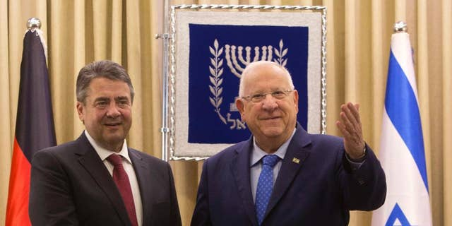 """German Foreign Minister, Sigmar Gabriel, left, shakes hands with Israel's President, Reuven Rivlin during their meeting at the President's residence in Jerusalem, Tuesday, April 25, 2017. Gabriel said Tuesday it would be """"regrettable"""" if Israeli Prime Minister Benjamin Netanyahu cancels their planned talks in Jerusalem because of his meeting with groups critical of Israel's actions in the West Bank, but downplayed the spat. (AP/Sebastian Scheiner)"""