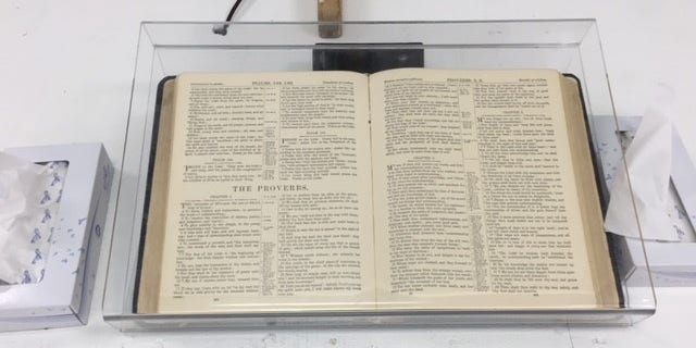 A Bible is displayed inside the First Baptist Church.
