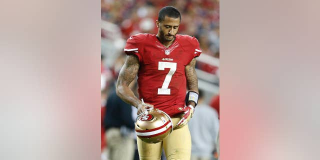 San Francisco 49ers quarterback Colin Kaepernick (7) walks on the field during the fourth quarter of an NFL football game against the Chicago Bears in Santa Clara, Calif., Sunday, Sept. 14, 2014. (AP Photo/Tony Avelar)