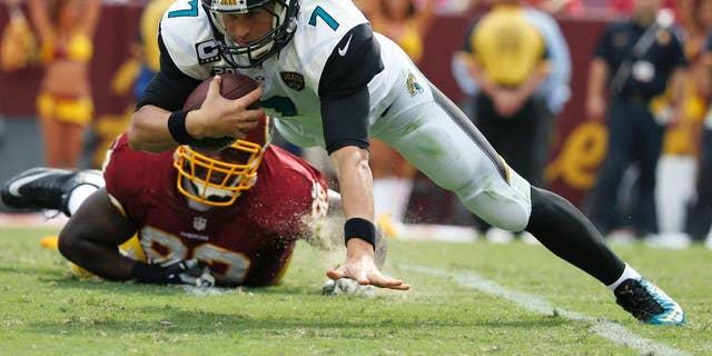 Jacksonville Jaguars quarterback Chad Henne (7) is sacked by Washington Redskins defensive end Chris Baker (92) during the second half of an NFL football game Sunday, Sept. 14, 2014, in Landover, Md. The Redskins won 41-10. (AP Photo/Evan Vucci)