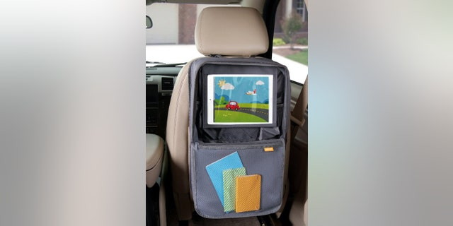 This handy backseat holder displays your favorite tablet while also keeping other knick knacks organized.