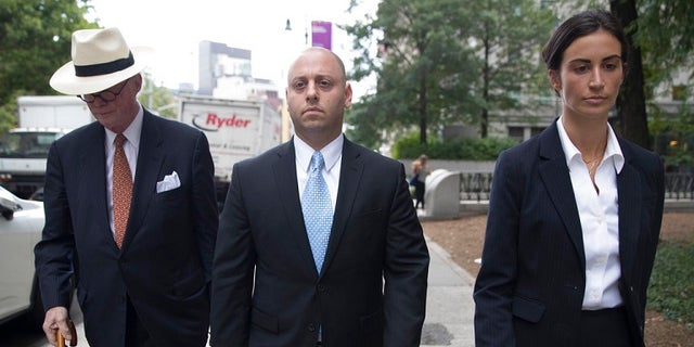 Adam Skelos, center, leaves federal court, Tuesday, July 17, 2018, in New York City.