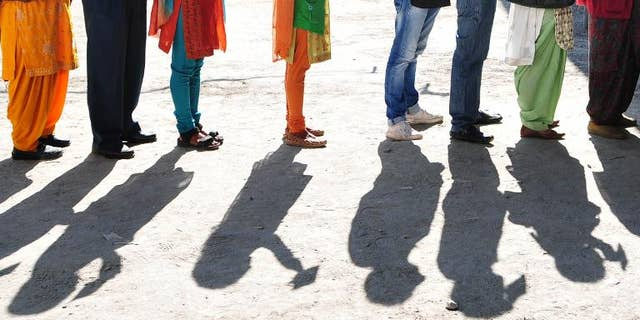 Indian voters wait to vote at a polling station in Devrighat, Himachal Pradesh. India's Supreme Court recognised on September 27, 2013 the right of voters to reject all candidates contesting in polls in what is seen as a key reform ahead of elections next year.