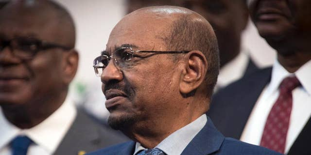 FILE - In this June 14, 2015, file photo, Sudanese President Omar al-Bashir attends a photo session at the African Union summit in Johannesburg. South Africa has decided to withdraw from the International Criminal Court following a dispute over the visit by al-Bashir, who is wanted by the tribunal for alleged war crimes, crimes against humanity and genocide. (AP Photo/Shiraaz Mohamed, File)