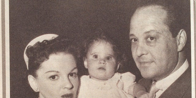 "Lorna Luft as a baby with her mother, Judy Garland and father, Sid Luft on the set of ""A Star Is Born."""