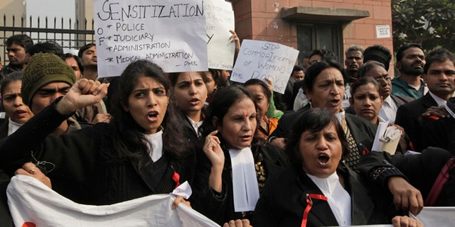 Jan. 3, 2013: Indian women lawyers shout slogans against police and the government outside the District Court complex where a new fast-track court was inaugurated Wednesday to deal specifically with crimes against women, in New Delhi, India.