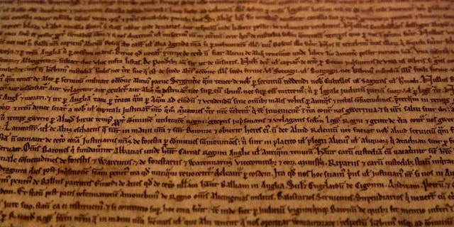 A detail of the Salisbury Magna Carta one of the four original surviving Magna Carta manuscripts that have been brought together by the British Library for the first time, on display at the library during a media preview in London in 2015. The document established the timeless principle that no individual, even a monarch, is above the law. (AP Photo/Alastair Grant)