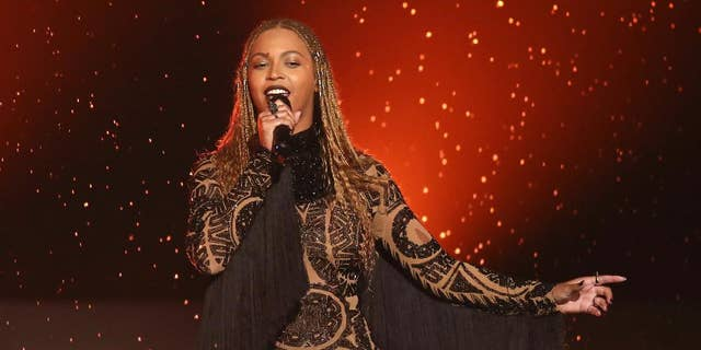 "FILE - In this June 26, 2016, file photo, Beyonce performs ""Freedom"" at the BET Awards in Los Angeles. There are few things Beyonce has not conquered, and the Grammy for album of the year is one of them. Beyonce's main competition is Adele, who won album, song and record of the year in 2010 with ""21"" and ""Rolling In the Deep."" The 2017 Grammy Awards are held Sunday, Feb. 12, 2017. (Photo by Matt Sayles/Invision/AP, File)"