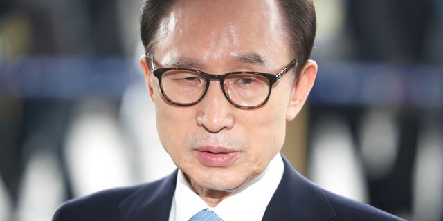 FILE: South Korea's former president Lee Myung-bak arrives at the prosecutors' office in Seoul.
