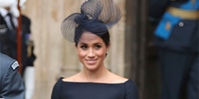 Meghan, the Duchess of Sussex, leaves after a service at Westminster Abbey to mark the centenary of the Royal Air Force, in London.