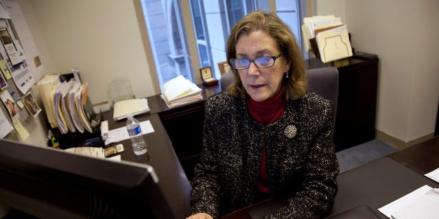 Lynn Feinberg, a caregiver expert at AARP, works in her office.  (AP Photo/Evan Vucci)