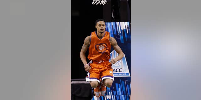 Clemson's K.J. McDaniels warms up during an NCAA college basketball practice for the Atlantic Coast Conference tournament in Greensboro, N.C., Tuesday, March 11, 2014. (AP Photo/Gerry Broome)