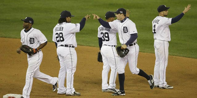 October 16, 2013: The Detroit Tigers players celebrate after Game 4 of the American League baseball championship series against the Boston Red Sox Wednesday in Detroit. The Tigers won 7-3. (AP Photo/Carlos Osorio)