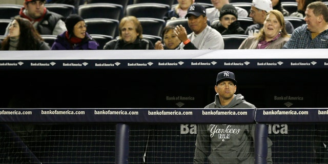 Oct. 13, 2012: New York Yankees' Alex Rodriguez watches from the bench in the ninth inning of Game 1 of the American League championship series against the Detroit Tigers in New York.